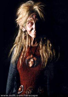 """Noranti (played by Melissa Jaffer) – The Noranti (Utu Noranti Pralatong) debuts in """"Dogs with Two Bones"""". where it suddenly appears amongst the crew as a mysterious and eccentric refugee that escaped to Moya along with an unidentified group of others as a Peacekeeper Command Carrier was being destroyed. The """"Old Woman"""", as she is called, is a Traskan, and little is known of her past before she joined the crew."""
