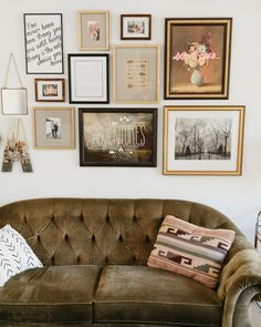 The combination of black, natural wood, and metallic gold frames takes this gallery wall to a beautiful and well-balanced place!