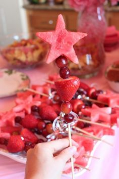 Skewer purple grapes with strawberries, topped with a watermelon star. So cute for a princess party!