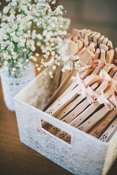 Prepare fans for your guest at an outdoor summer wedding. Ben Yew Photography