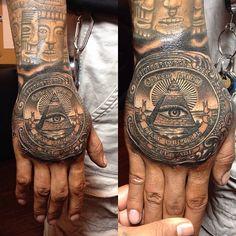 Hand tattoo money eye.