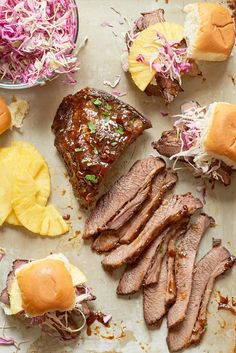 Recipe: Slow Cooker Hawaiian Brisket Sandwiches | Pillowy-soft Hawaiian rolls piled high with slices of tender beef brisket and sweet pineapple, all topped with a crunchy, refreshing cabbage slaw.