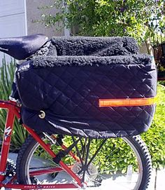 Large pet bicycle basket mounts on the rear and holds larger dogs than front-mounted baskets. This is the original Snoozer Pet Rider Bicycle Basket for pets up to about 15 pounds (please refer to dime