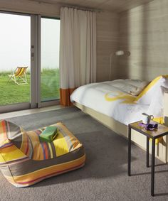 wood walls + chair + simplicity = beach cottage via Jarlath Mellett