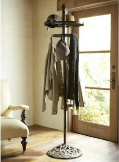 SPACE SAVER: ROTATING COAT RACK. Great tovput in CLOSET CORNER, for half used clothes or bulky items like winter coats.