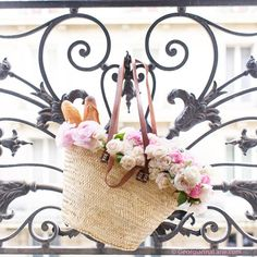 Flowers and baguettes from rue Cler on the balcony of @parisperfectrentals…