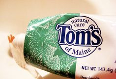 WARNING: Not Natural. You've been lied to, again. This might be shocking to some but Tom's of Maine isn't owned by Tom and is not from Maine. In fact, it's owned by a well-known corporate giant — Colgate-Palmolive of New York. http://livingtraditionally.com/warning-toms-of-maine-products-are-not-so-natural-youve-been-lied-to-again/