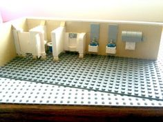 A complete walk-through of the construction of a basic LEGO public restroom which includes privacy dividers, toilets, sinks, and other restroom accessories. Cool Lego, Awesome Lego, Lego Bathroom, Lego Furniture, Lego Boards, Lego Christmas, Public Bathrooms, Lego Architecture, Lego Models