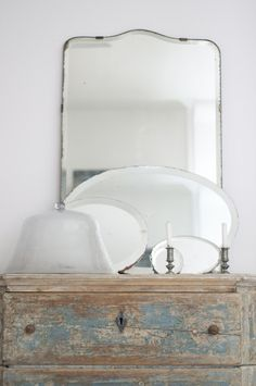 painted chest, frameless mirror, oval platters, cloche