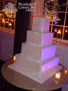 Simplicity in White Pearl Buttercream Wedding Cake  you could do this with normal buttercream icing.  Just have it smoothed out, but the sparkles look nice.