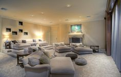The theatre room in Mark Wahlberg's house, although if I owned this thirteen million dollar home, I would double this as a library lounge, too!