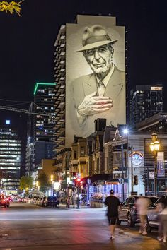 The late Leonard Cohen looking over Crescent street in Montreal, which used to be one of his favourite places to go. Visit Canada, O Canada, Canada Travel, Alberta Canada, Montreal Ville, Montreal Quebec, Montreal Travel, Leonard Cohen, Montreal Canada