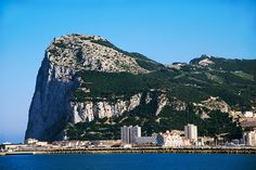 Gibraltar, a tiny British colony in the land of Spain. This headland, just a few kilometres off the coast of northern Africa, is the extreme edge of the Ancient Mediterranean and once corresponded as the end of the world.  It is a strange place.  People say that it is the corner of England nestled in the warm colors of Spain.  Spain has tried many times to regain control over it, but the Brits have dug in tight!