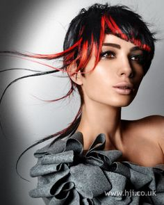 Layers were cut into a short crop, with strands of extensions in contrasting colours added all over.