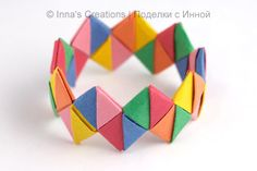 Folded paper bracelet. Try colors in the same family or mix it up for a fun accessory. (Step-by-step instructions included.)
