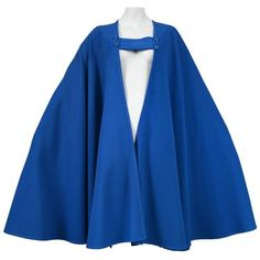 Pre-owned Yves Saint Laurent Blue Wool Cape ($2,000) ❤ liked on Polyvore featuring outerwear, cape, blue, blue cape coat, wool cape coat, wool cape, blue cape and cape coat
