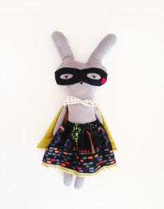 This quirky little super bunny is an unique play companion to any child. She is made of soft minky fabric and designer 100% cotton fabric. Her mask is