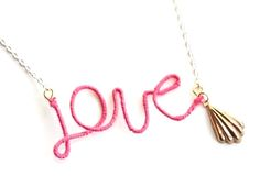 this is so cute!  ( although I would prob do it in silver... not too into gold lol) thread wrapped wire word necklace!