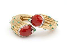 A coral, emerald, diamond and gold bangle - est: $3000/5000