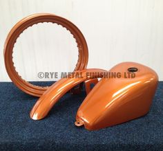 Harley Davidson parts powder coated in candy copper.