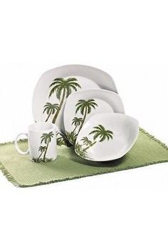 This dinnerware set features a palm tree motif that is ideal for everyday use. The 32 piece set, palm tree collection, includes 8 dinner plates, 8 salad plates, 8 bowls and 8 mugs. Dinnerware Set Tropical Palm Tree Dishwasher Safe Microwave Safe Freeze Safe Oven Safe Ceramic 32 Piece Setting Serve 8 8 Dinner Plates 8 Salad Plates 8 Bowls 8 Mugs FREE SHIPPING!