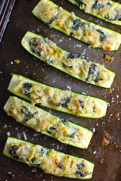 This Spinach Artichoke Stuffed Zucchini Recipe has all the goods! It tastes delicious and indulgent but it's healthy too with so many nutrient-dense veggies! Each fantastic bite gives you creamy artichoke nutty and cheesy Parmesan fresh spinach and Veggie Recipes, Gourmet Recipes, Cooking Recipes, Healthy Recipes, Stuffed Zucchini Recipes, Vegetarian Recipes, Sin Gluten, Clean Eating Snacks, Healthy Eating