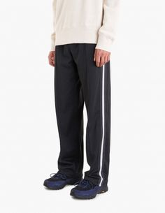 "Trousers from <a href=""http://tres-bien.com/our-legacy/"" class=""uniquelink"">Our Legacy</a>. Elasticated waist with drawstrings. Two zipped front pockets. Striped textile ribbon on the sides. Straight legs with pleats on the front and back."