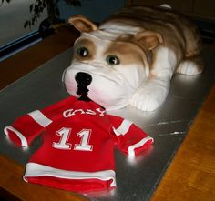 Couple's dog taking replica of groom's hockey jersey. #DogCake #Aspoonfullasugar #Groomscakes