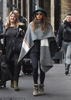 Nicole Scherzinger.. Topshop Stripe Tape Edge Cape, and Isabel Marant the Bekett Suede Concealed Wedge Sneakers.. love!!