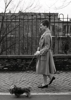 Audrey Hepburn walking her dog Mr. Famous in Rome, 1959.