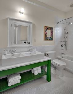 In the running for #1 bathroom:  Absolutely love the green vanity; deep sinks; penny tile floor
