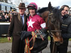 Sir Des Champs with Davy Russell and Willie Mullins after his win at Leopardstown.