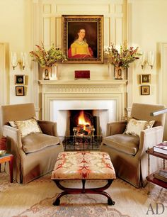 An 18th-century portrait hangs above the library's mantel, which was custom made by Gaston & Wyatt; the armchairs are upholstered in a Loro Piana cotton blend, and the Victorian stool is clad in a Zoffany damask.