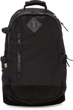 Unstructured Cordura® nylon backpack in black. Detachable tonal suede padding at carry handle. Adjustable shoulder straps featuring tonal grosgrain strap with press-release fastening. Tonal rubberized accent and zippered pocket at face. Patch pockets with Velcro fastening at sides. Zippered vent and curved clip hardware at side. Padded panel and zippered compartment at back face. Tonal textured suede panelling at reinforced base. Two-way zip closure at main compartment. Zippered pocket…