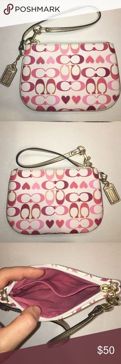 Coach Peyton Signature Heart Wristlet 💎RARE💎 Never used Coach Peyton Signature Heart Small Wristlet. Interior features one open pocket. Measures approx 6.5 inches across and 4.5 inches from top to bottom. Wristlet was never used but I did detach the tag. Very rare print! Matching ID holder also available in my closet. Coach Bags Clutches & Wristlets