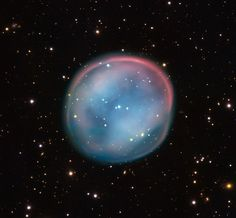 The shimmering orb ESO 378-1, nicknamed the Southern Owl Nebula,