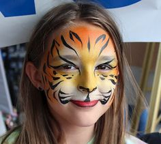 Paint Savvy parties, events and entertainment: Face painting tiger, face painting skull, face painted warrior, Paint Savvy