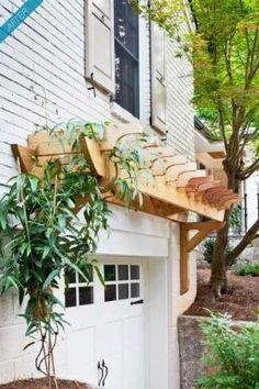 Simple pergola over garage door. I think this would look good black pergola over a brick exterior. Outdoor Spaces, Outdoor Living, Outdoor Decor, Diy Trellis, Garage Trellis, White Trellis, Rose Trellis, Cheap Pergola, Pergola Ideas