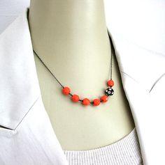 orange and black necklace