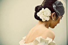 LOVE the white flower against the dark hair.