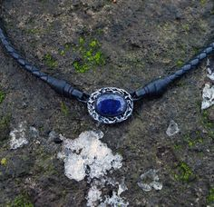 """Unisex handmade leather pendant with 100 %  Natural Sapphire.     The pendant measures 2.5 x 2 cm or 1"""" х 0.8"""" inches. The cord is 46 cm or 18.1 """" inches  with 5 cm (2 inch) extension chain. If you want other length, just let me know.  Stone size - 16 x 11 mm.    The pendant will arrive gift boxed ready for giving.    The magnificent and holy Sapphire, in all its celestial hues, is a stone of wisdom and royalty, of prophecy and Divine favor. To the ancient and medieval world, Sapphire of…"""