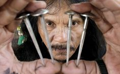Filipino Ruben Enaje shows four three-inch, stainless steel nails that will be used to nail him to a cross on Good Friday, at his home in San Pedro Cutud village, San Fernando city, north of Manila, Philippines. very year, thousands of foreign and local visitors flock to San Pedro Cutud village to watch a reenactment of the crucifixtion of Jesus Christ.