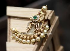 A traditional tigers claw motif pendant set with a synthetic tiger claw composite with a peacock design and pearls from C Krishniah Chetty Sons. Gold Earrings Designs, Gold Jewellery Design, Necklace Designs, Designer Jewellery, Silver Jewellery, Silver Rings, Gold Jewelry Simple, Golden Jewelry, Gold Pendent