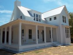 Light cream/grey and White House exterior Hamptons style white colourbond roof