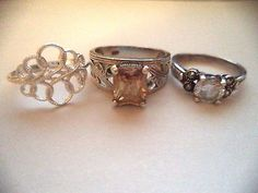 Lot of three rings sterling silver sz.9-10 yellow stone  *pretty vintage rings*