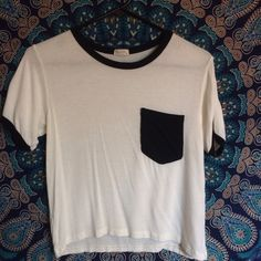 Brandy Melville ringer T Black and white T shirt with black pocket. Worn a couple of times but still in good condition. Super soft and semi-cropped. Easily fits a medium too. Brandy Melville Tops Crop Tops