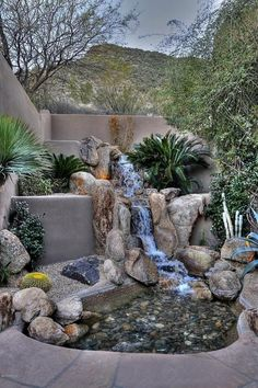 Backyard Landscaping Ideas - This luxury Arizona desert home combines waterscaping, xeriscaping and desertscaping to create a sustainable outdoor environment. It all starts with the rock water garden and waterfall at the front door. Desert Backyard, Ponds Backyard, Backyard Waterfalls, Garden Ponds, Arizona Backyard Ideas, Garden Water Fountains, Outdoor Fountains, Outdoor Patios, Water Gardens