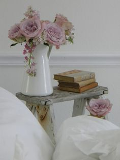 table, flowers and books so cozy :)