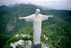 Christ the Redeemer is a statue in Rio de Janeiro, Brazil that was built as a symbol of Brazilian Christianity. Christ the Redeemer is an Art Deco statue Oh The Places You'll Go, Places To Travel, Places To Visit, Travel Destinations, New Seven Wonders, Wonders Of The World, Dream Vacations, Vacation Spots, Vacation Places