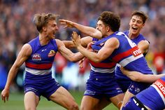Western Bulldogs Photos Photos - Western Bulldogs players celebrate at the end the 2016 AFL Grand Final match between the Sydney Swans and the Western Bulldogs at Melbourne Cricket Ground on October 1, 2016 in Melbourne, Australia. - AFL Grand Final - Sydney v Western Bulldogs